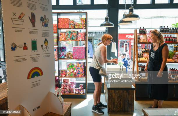 People are asked to wash their hands when entering the shop 'Lush' in the town centre on June 15, 2020 in Bournemouth, United Kingdom. The British...