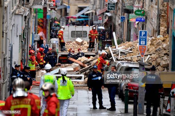 People are at work at the start of the clearance work at the site where two buildings collapsed resulting in at least two people injured on November...
