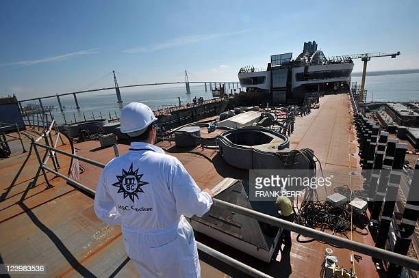 People are at work on the upper deck of the MSC Divina liner on September 02 2011 at the 'Chantiers STX' building site in SaintNazaire western France...