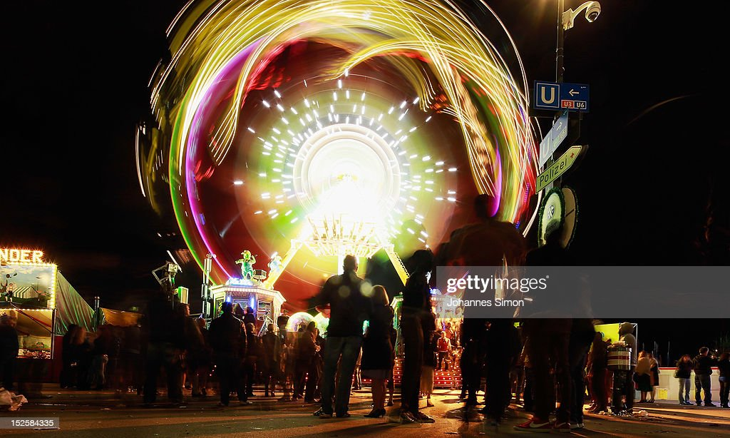 People are attracted by a luminous merry-go-round in the evening of day 1 of Oktoberfest beer festival on September 22, 2012 in Munich, Germany.This year's edition of the world's biggest beer festival Oktoberfest will run until October 7, 2012.