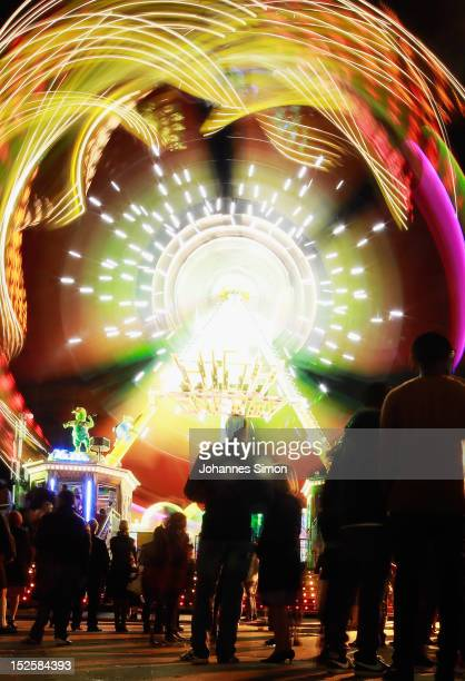 People are attracted by a luminous merrygoround in the evening of day 1 of Oktoberfest beer festival on September 22 2012 in Munich GermanyThis...