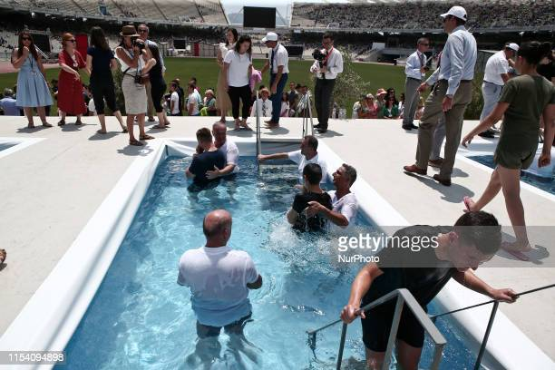 People are baptized the second day of the Jehovahs Witnesses Convention at the Olympic stadium in Athens Greece on July 6 2019