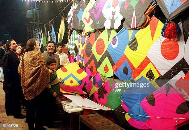 People are busy shopping for kites on the eve of Basant a kite festival in Pakistani eastern city of Lahore 17 February 2001 The Kite festival will...