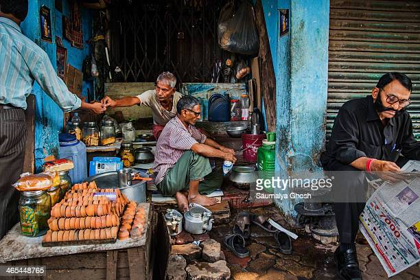 CONTENT] People are busy working at a Roadside tea stall in Kolkata
