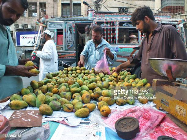 people are buying things for iftar - for stock pictures, royalty-free photos & images