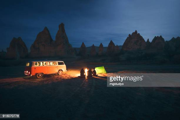 people are camping in moonlight in cappadocia, turkey - volkswagen stock pictures, royalty-free photos & images