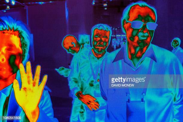 TOPSHOT People are captured by FLIR HD Thermal Imaging Cameras as they walk near the FLIR exhibit at the Las Vegas Convention Center during CES 2019...