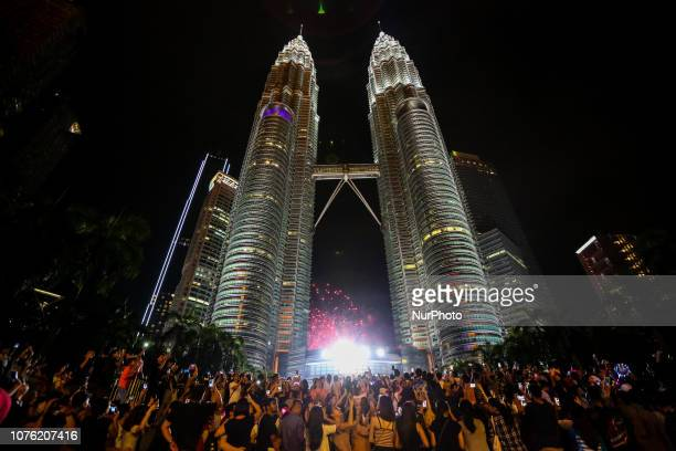 People are celebrating the start of the new year in front of the Twin Towers quot Petronas Twin Towers quot in Kuala Lumpur Malaysia on 1st January...