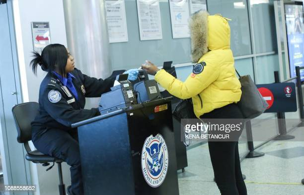 People are checked by the TSA in a security screening line at La Guardia Airport on January 25 2019 in New York The Federal Aviation Administration...