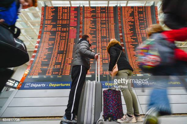 People are checking their flights on the Departures board at the Terminal 2 of Paris Charles de Gaulle Airport. On Sunday, 12 February in Paris,...