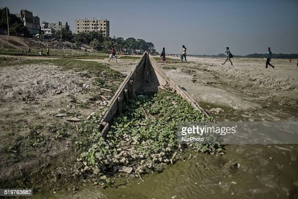 People are crossing river brahmaputra on foot as there are no water at Mymensing bangladesh 12 April 2015 Climate change in Bangladesh is an...