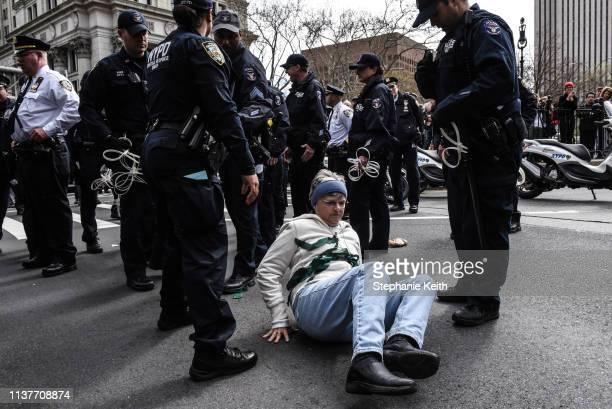 People are detained while participating in a direct action with a group protest organization called Extinction Rebellion on April 17 2019 in New York...