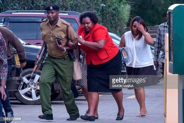 People are evacuated as a gunfight was underway following a blast at a hotel and office complex in Nairobi on January 15 2019 A blast at the DusitD2...
