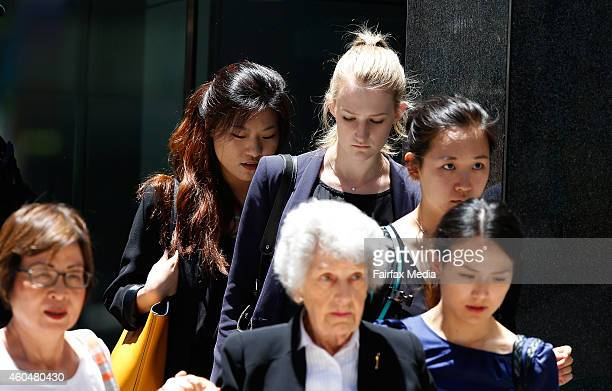 People are evacuated from a building next to the Lindt Chocolate Café which is under siege in Martin Place Sydney on December 15 2014 in Sydney...