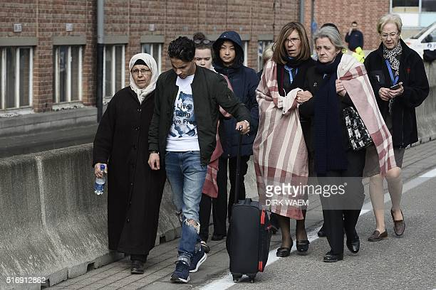 People are evacuated from Brussels Airport in Zaventem on March 22 2016 after two explosions in a hall of the airport A string of explosions rocked...