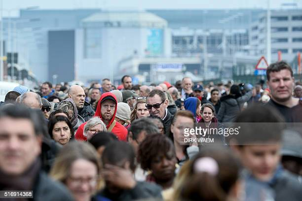 People are evacuated from Brussels airport in Zaventem on March 22 2016 following twin blasts A string of explosions rocked Brussels airport and a...