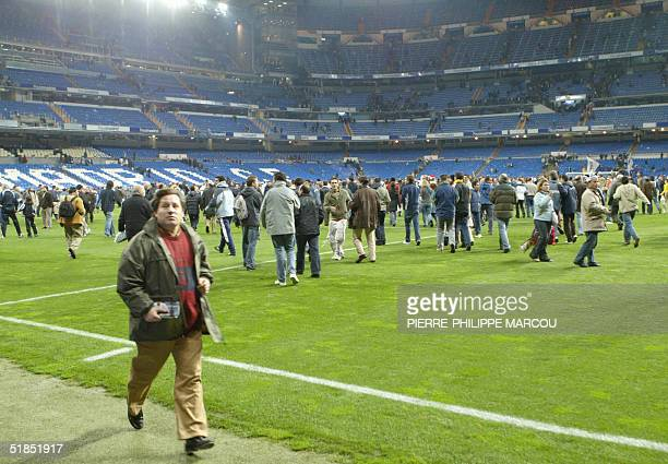 People are evacuated from the stadium after a bomb alert during the Premier League football match between Real Madrid and Real Sociedad in Santiago...