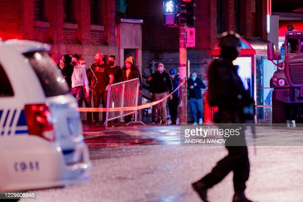 People are evacuated from the Ubisoft office as Montreal police respond to a possible hostage-taking at the Ubisoft office in the Mile End, on the...