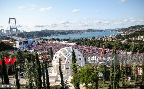 People are gathered in front of July 15 Martyrs' Memorial before it's opening ceremony at 15 July Martyrs Bridge during the July 15 Democracy and...