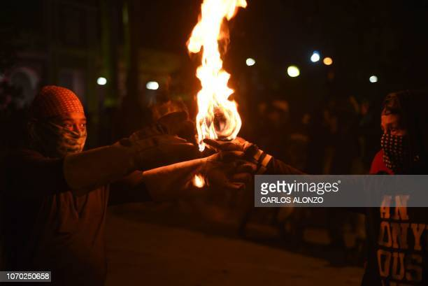 People are getting ready to throw a fireball in the main street of the city of San Cristobal Verapaz 210 km north of Guatemala city during the...