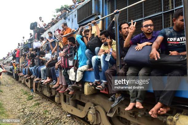 people are going home risky journey  by train to celebrate eid - eid ul fitr celebration in bangladesh stock pictures, royalty-free photos & images