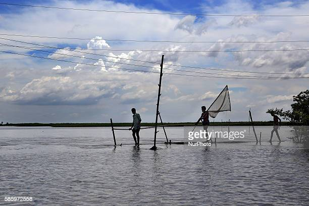 People are going to catch fish in the flood water Water from Jamuna river came all over the Islampur area and caused flood