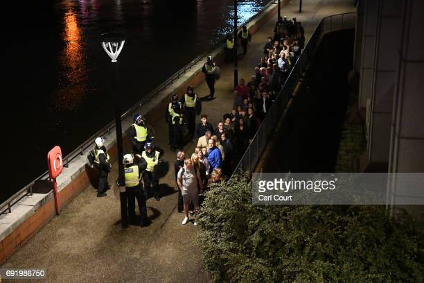 People are lead to safety away from London Bridge after an attack on June 4 2017 in London England Police have responded to reports of a van hitting...
