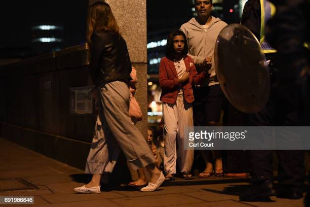 People are lead to safety on Southwark Bridge away from London Bridge after an attack on June 4 2017 in London England Police have responded to...