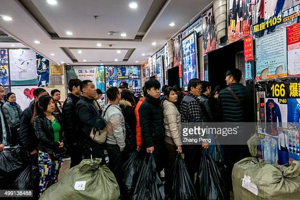 People are lined up waiting for the elevator who are mostly Taobao shop owners coming to look for goods resource An ecommerce base in Hangzhou where...