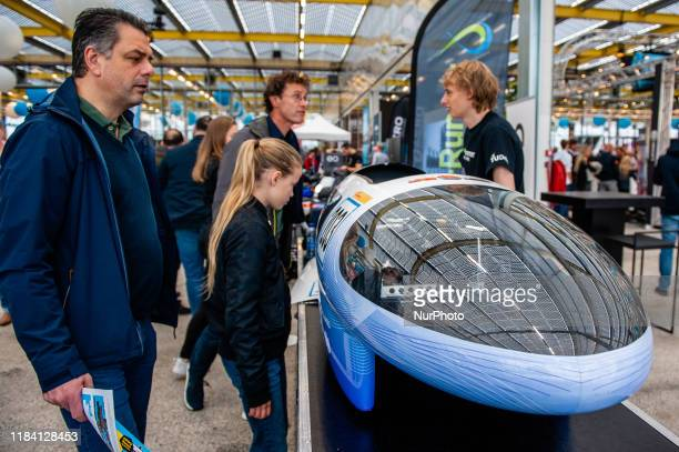 People are looking a solar vehicle during the Bright Day Festival in Amsterdam on November 23rd 2019
