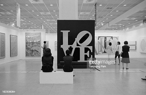 People are looking at the artwork who made an American pop artist Robert Indiana that title is the LOVE.