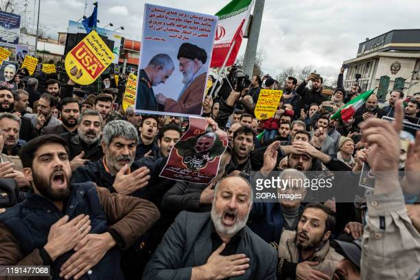 People are mourning the death of General Qasem Soleimani while holding flags and placards. After the killing of General Qasem Soleimani, commander of...