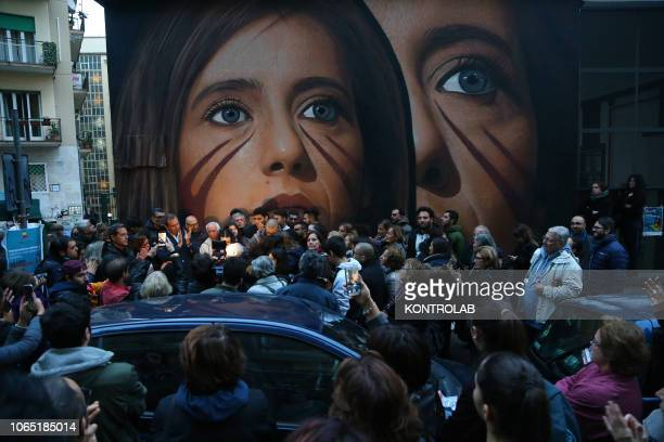 People are near the wall painting of Ilaria Cucchi made by the artist Jorit Agoch Ilaria Cucchi is the sister of Stefano dead in 2009 in prison after...