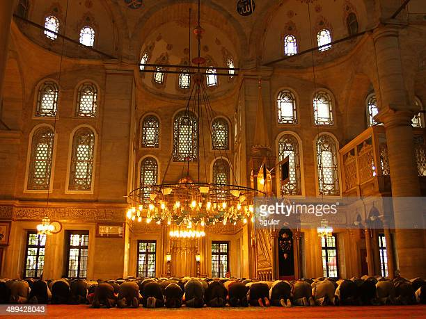 people are performing the namaz - namaz stock pictures, royalty-free photos & images