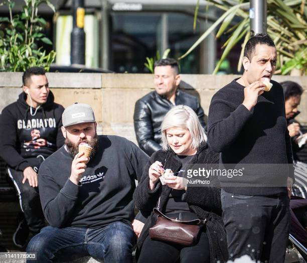 People are picture to eat ice cream in Central Manchester 4 May 2019