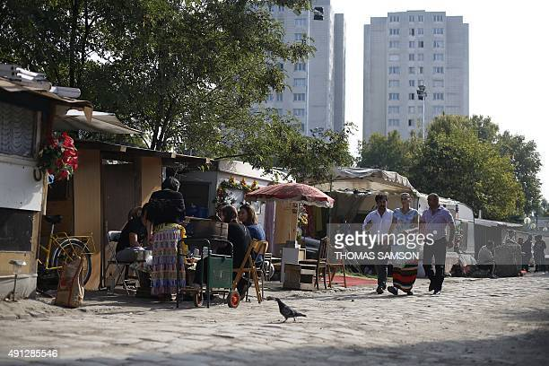 People are pictured in a Roma camp set up in SaintDenis northern Paris suburbon October 4 2015 AFP PHOTO / THOMAS SAMSON