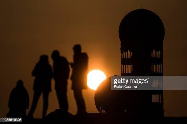 People are pictured in front of the former US listening station on 'Teufelsberg' at sunset on January 20 2019 in Berlin Germany