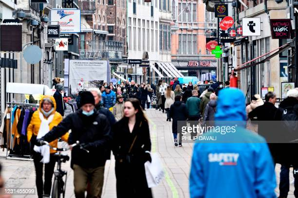 People are pictured in the center of Copenhagen, on March 1, 2021 as stores reopen after several months of closing, amid the ongoing coronavirus...