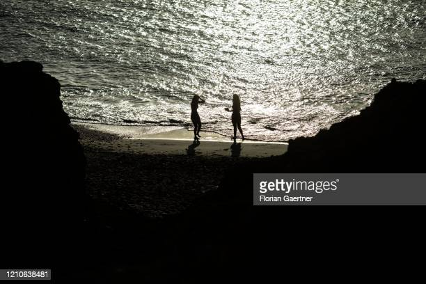 People are pictured on the beach at the desert La Guajira in the northernmost part of Colombia on March 01, 2020 in Cabo de la Vela, Colombia.