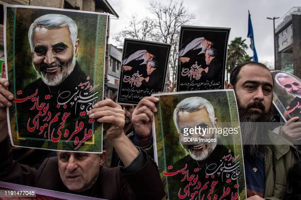 People are protesting against the death of General Qasem Soleimani while holding his portrait After the killing of General Qasem Soleimani commander...