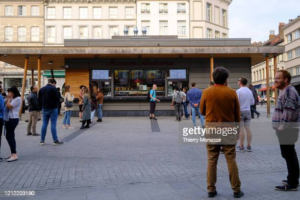 People are queuing for French Fries on 'Place Jourdan' Maison Antoine on May 8 2020 in Brussels Belgium In order to contain the spread of the severe...