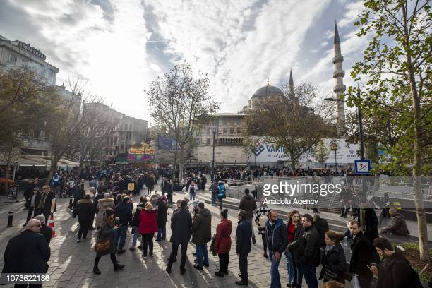 People are queuing up in front of Nimet Abla kiosk the most famous ticket agency in Istanbul to buy lottery tickets for Turkey's New Year lottery...