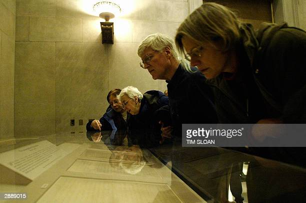 People are reflected in the display case holding the original Emancipation Proclamation on Martin Luther King Jr Day during a special oneday showing...
