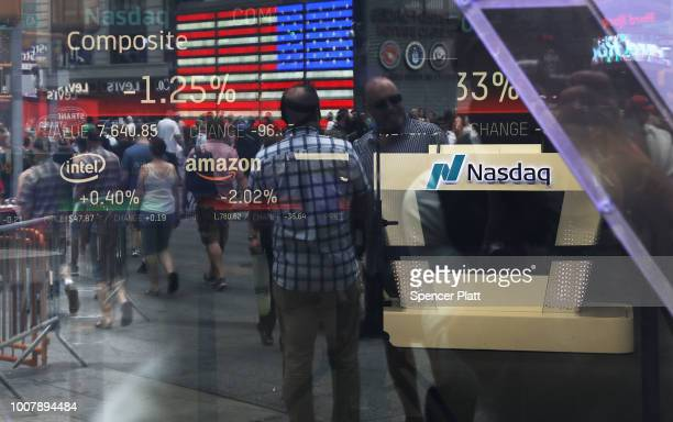 People are reflected in the window of the Nasdaq MarketSite in Times Square on July 30 2018 in New York City As technology stocks continued their...