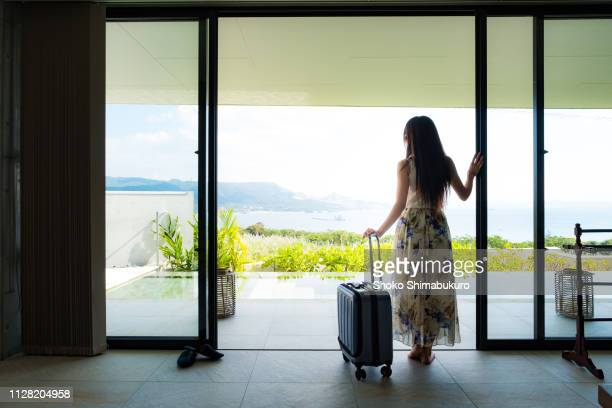 people are relaxing at a resort hotel in okinawa, a popular tourist destination in japan. - guest stock pictures, royalty-free photos & images