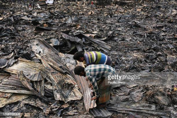 People are removing the debris and searching if there is anything left of their home Hundreds of shanties were razed to the ground leaving thousands...