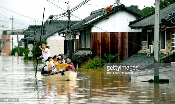 People are rescued as the Mabicho area is submerged after Odagawa River banks collapse due to heavy rain on July 7 2018 in Kurashiki Okayama Japan 51...