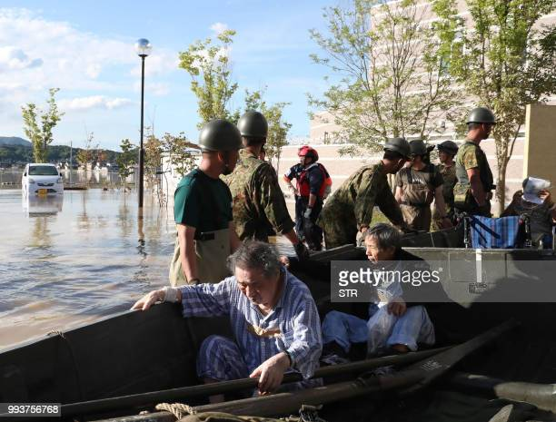 People are rescued by SelfDefense Forces personnels from Mabi Memorial Hospital that was isolated due to flood damage caused by heavy rain in...