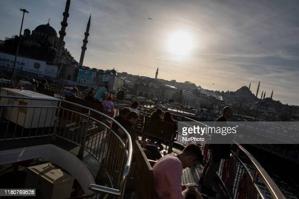 People are sailing in a ferry during hot weather in Istanbul Turkey on Nowember 072019