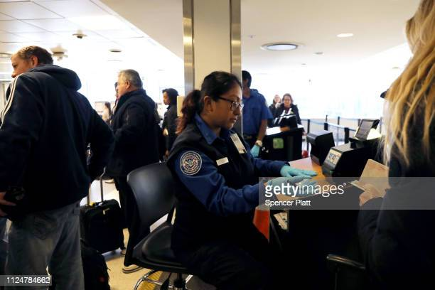 People are screened by the TSA on a security screening line at LaGuardia Airport after the Federal Aviation Administration announced it is delaying...